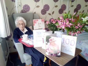 Sr Maureen Quinn on her 100th birthday with all her flowers and cards, including one from Her Majesty the Queen Elizabeth